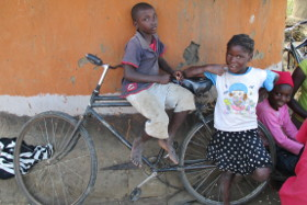 Children on a bycicle in Zambia